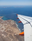 Leaving Mykonos with Dilos and Rineia in the distance