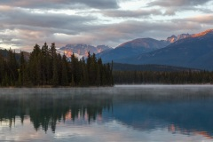First light on Mount Edith Cavell reflected in Beauvert Lake