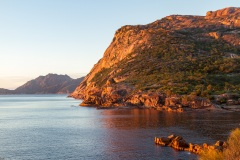 First sun hits the red rocks of Sleepy Bay