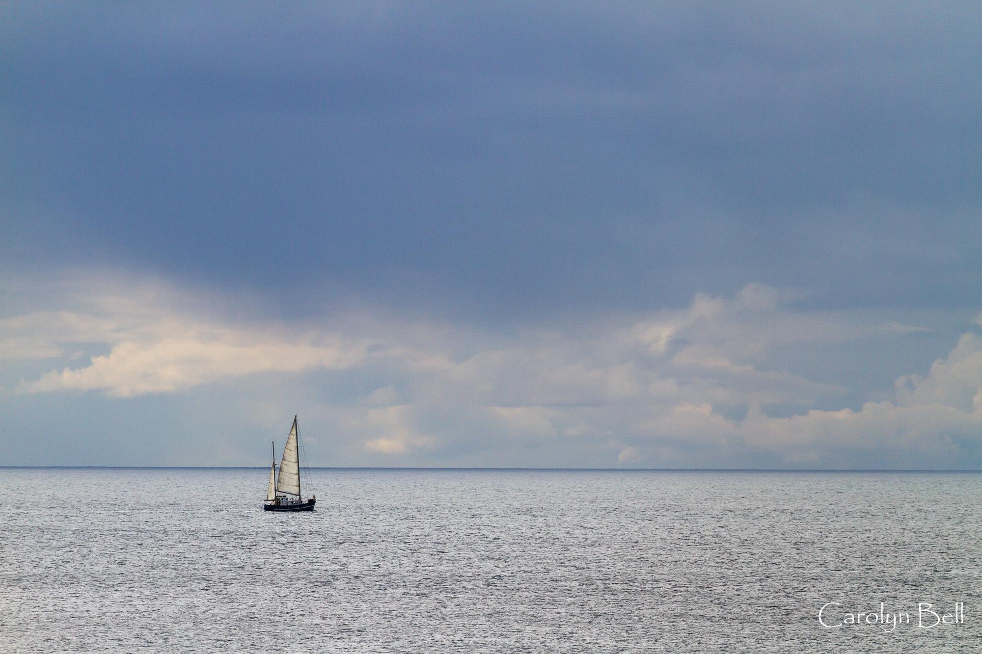 Lone yacht Nesland peninsula, Lofoten, Norway