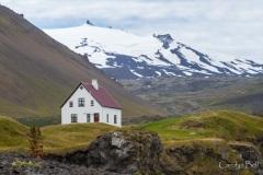 The white house at Arnarstapi with Snaefellsjokull behind