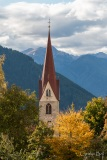 Church spire at Luson with hanglider